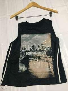 black sleeveless with statement top