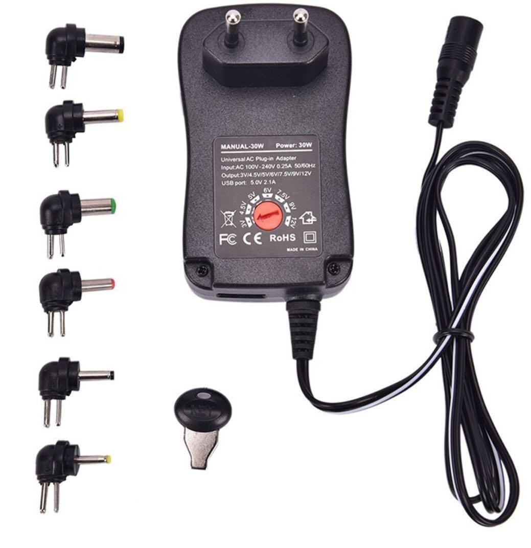 (E1066) Universal Adapter 3v , 4 5v, 5v, 6v, 7 5v, 9v, 12v