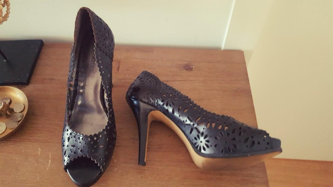 Nine West size 8 (on the larger size ) worn once at a wedding - stunning cut out feature.