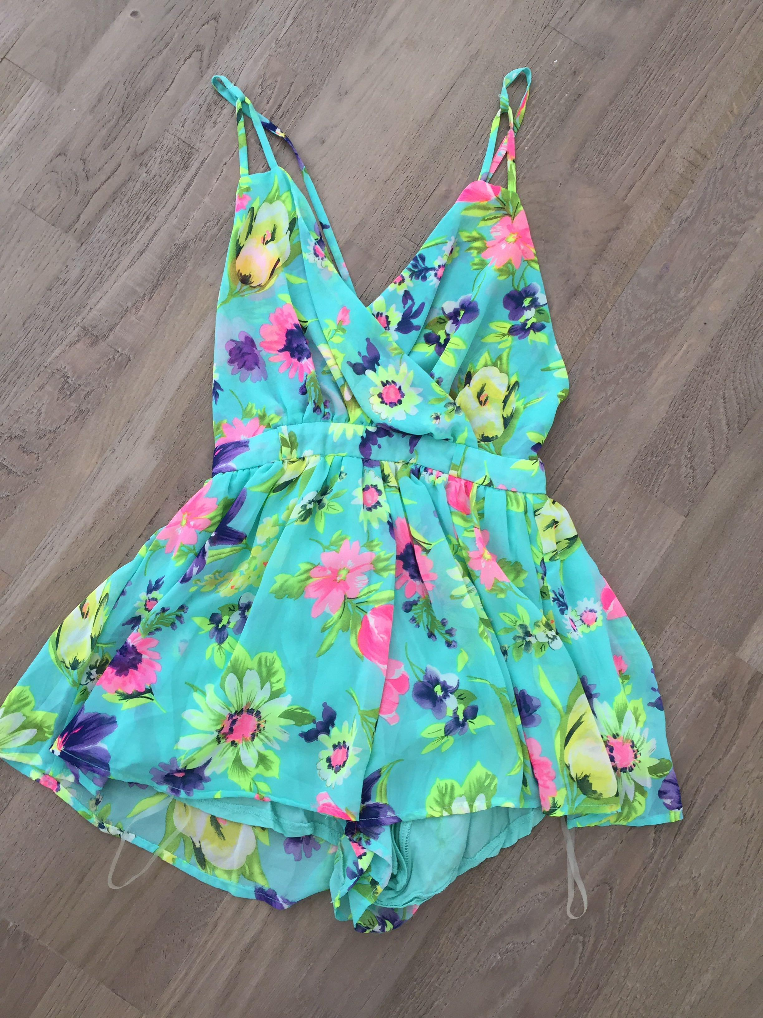 Size 6 colourful playsuit with Criss cross back. Excellent condition