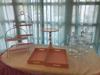 🚚 Pink color cake stand, dessert trays and decoration items for rent