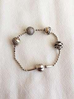 Pandora essence bracelet and beads