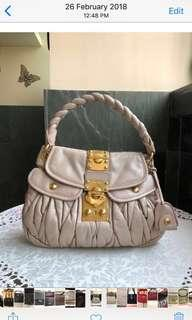 Almost brand new Miu Miu coffee lambskin bag. Used once only. Medium size. Good condition inside n out. Light n spacious, can put a lot of things. Retail @$2500 plus.