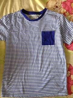 Blue and white striped top with pocket