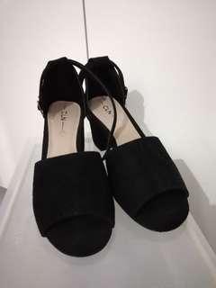 CLN black heels