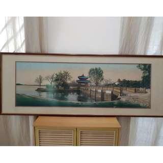Scene of pagoda by the lake tapestry in frame