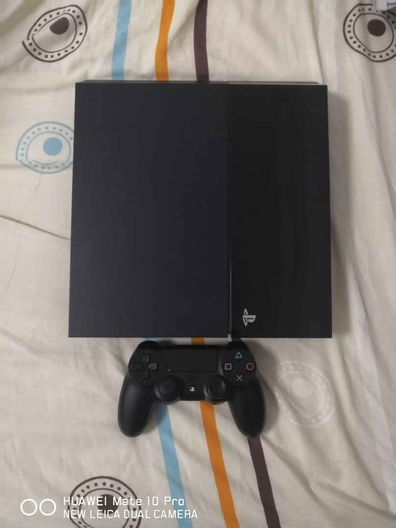 PS4 Jet Black with 2 games