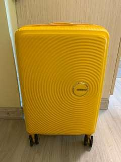 American tourister curio spinner yellow