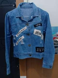 Rip jeans jacket dream big