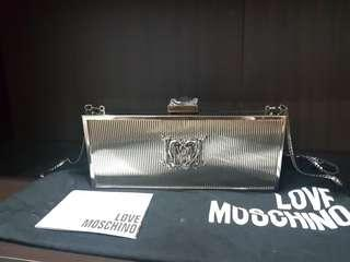 Preloved Authentic Love Mochino Silver Metal 2 way Clutch or Sling Bag
