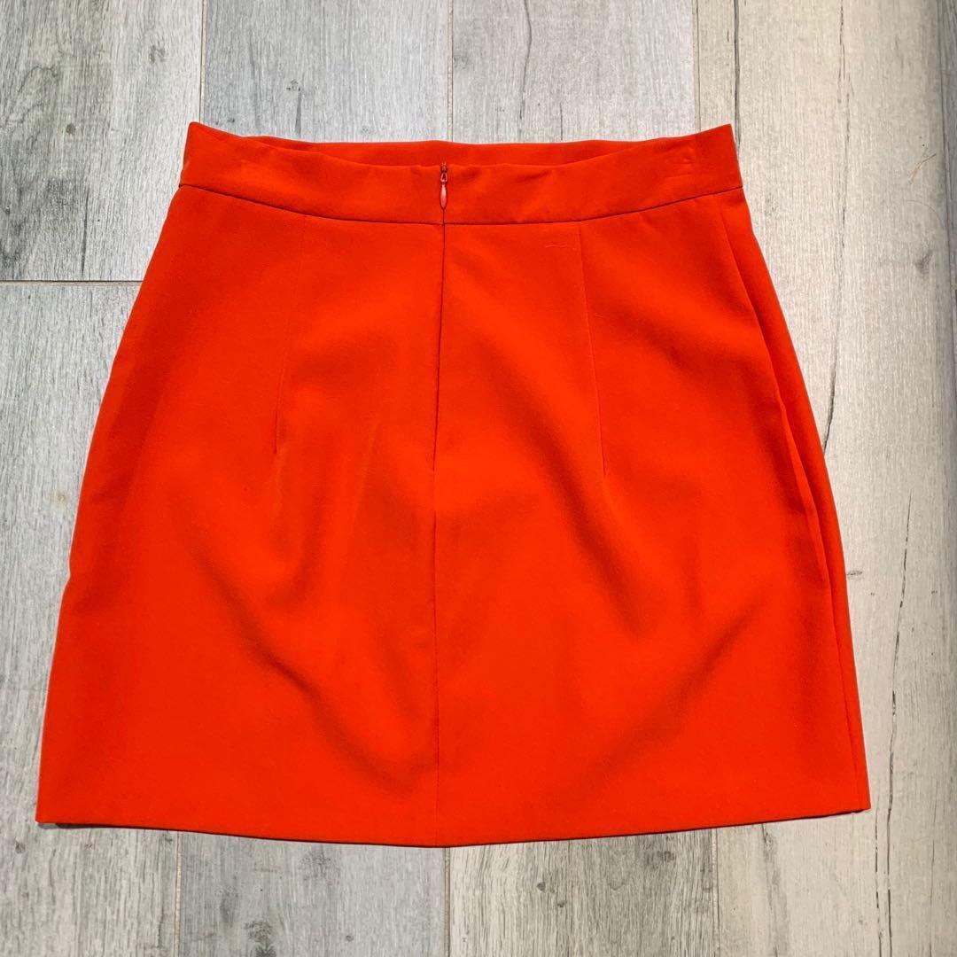 Zachary - Orange mini skirt