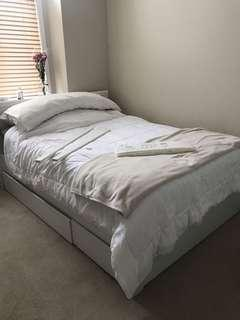 Double bed frame from Ikea. Storage drawers included