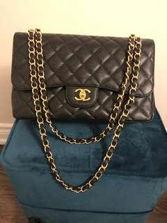 Like new authentic Chanel jumbo double flap purse in caviar leather
