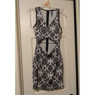 Medium Bodycon dress with midriff cutout. Black and white damask pattern.