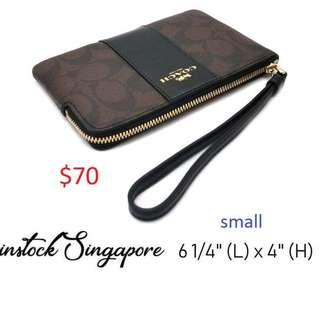 READY STOCK authentic new Coach CORNER ZIP WRISTLET IN SIGNATURE COATED CANVAS WITH LEATHER STRIPE F58035