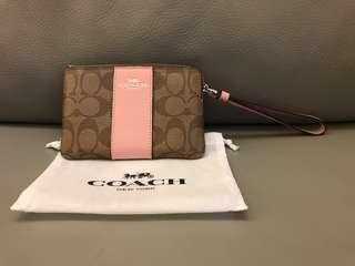 Coach wristlet in baby pink
