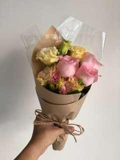 🚚 [Cheap af.] $5 only <Sold out> 3 pink roses bouquet with matching flowers, wrapped in brown paper wrapping.