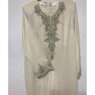 Cream colour kurung with beautiful embroidery