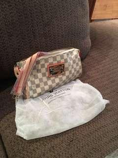 Louis Vuitton cross body purse I have 2 $25.00 dollars EACH