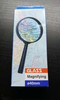 🚚 Green Magnifying Glass