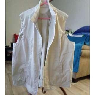 Creme cut off sleeve jacket