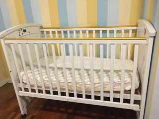 Solid white wooden baby cot. Free baby matress and comforter bumper