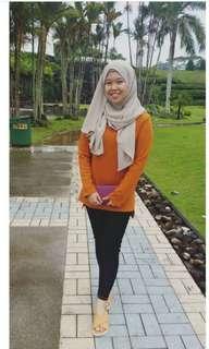 Orange coloured sweater tops