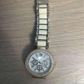 Very lightly used ( worn less than 5 times) Rose Gold and Cream Watch