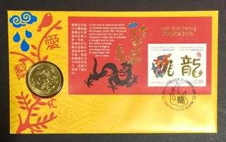 Australia year of the Dragon $1 coin on first day cover.