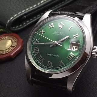 SOLD-    34mm Rolex Oysterdate 6694 in Lucky Cash Green