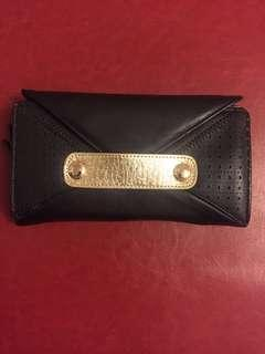 Brand new Fiorelli Megan black and gold purse with tags