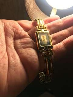 Authentic Givenchy Gold bangle watch