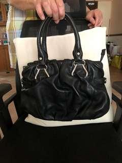 Brand new Le Saunders cowskin leather black quilted bag. Bot in Spain. Spacious n clean , can carry a lot of things.