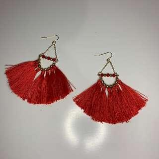 red frilly earrings