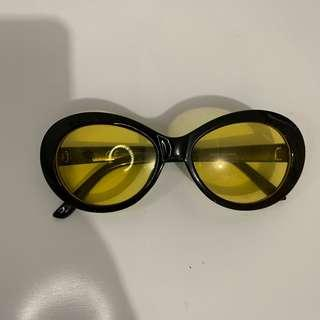 yellow lens black frame glasses