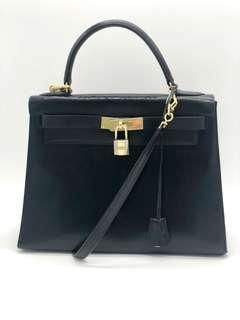 Hermès Kelly 28 cm black box leather bag with strap