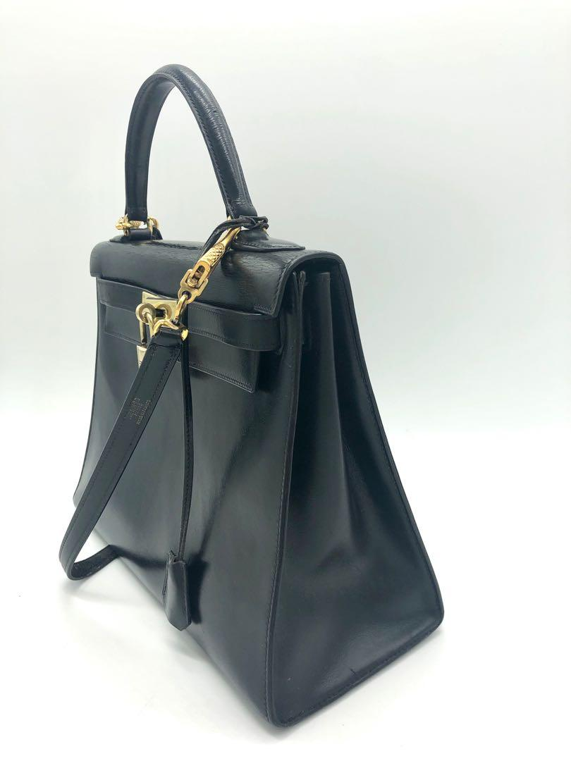 Hermès Kelly 28 cm black box leather bag with strap