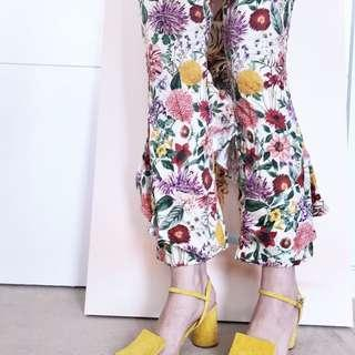 Floral ankle length trousers with ruffle detail