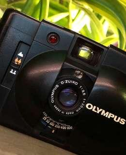 Olympus XA with flash (film)