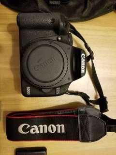 Canon 500D DSLR, with Canon 18-200mm Zoom Lens