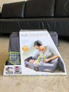 Baby travel bed, for changing diaper/napping/rest in a safe confined carrier. Brand New.