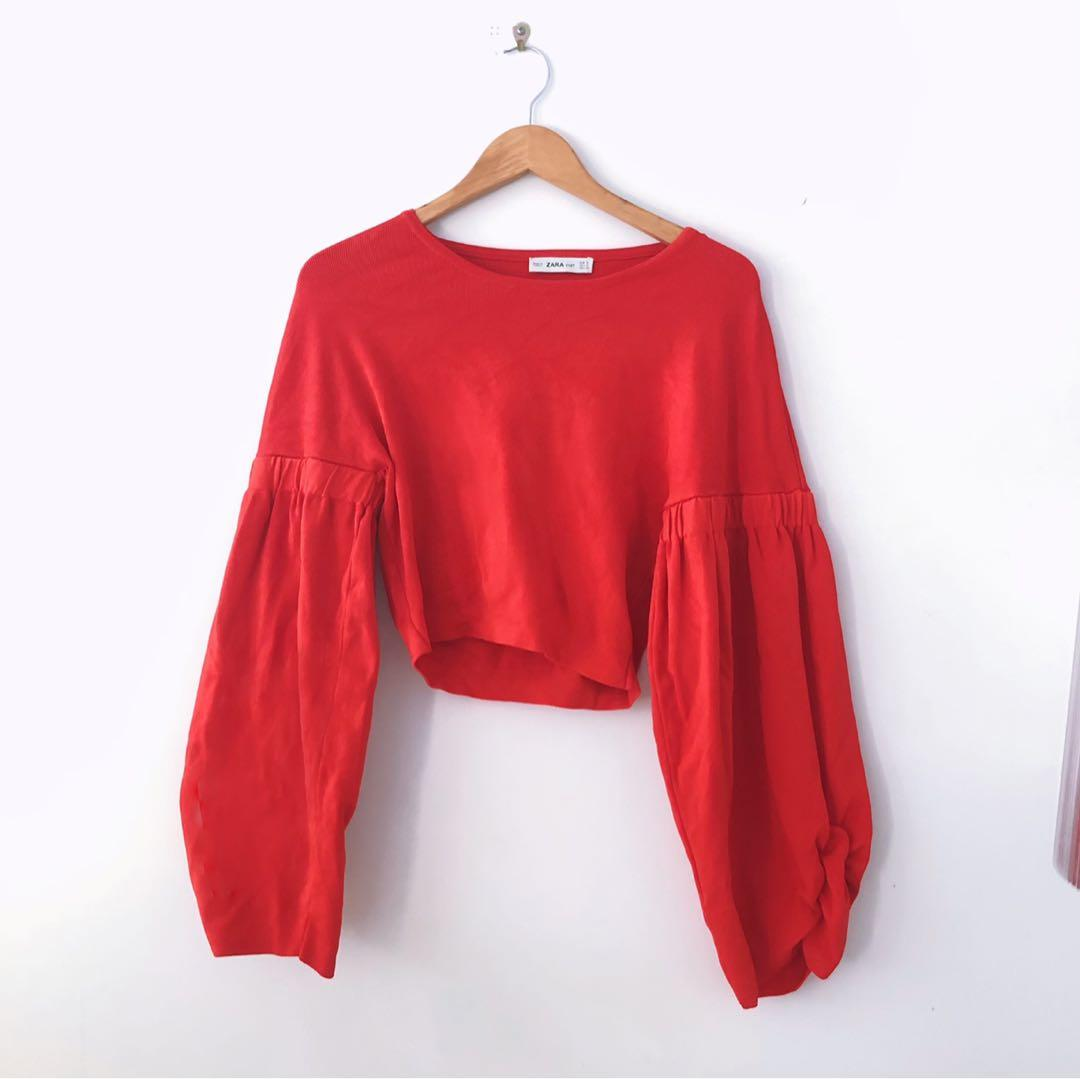 Red knit cropped sweater with gathered balloon sleeves