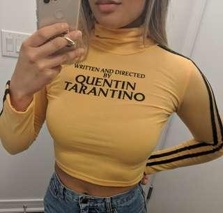 Quentin tarantino yellow crop turtleneck