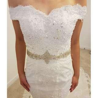 Off-shoulder beaded wedding lace dress with train