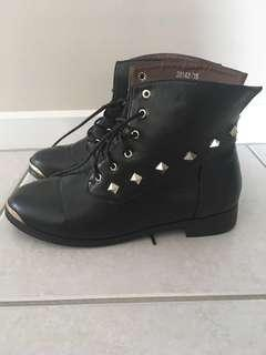 Black leather gold studded boots