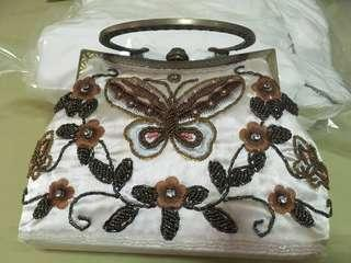 Intricately crafted ladies hand bag