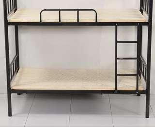 Bunk bed with two wooden bed boards
