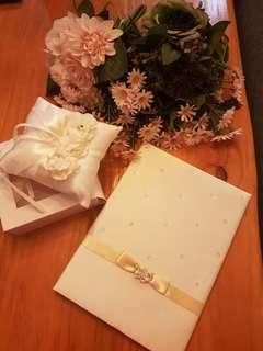 Brand new guest book, ring pillow and 4 bouquets of fake flowers