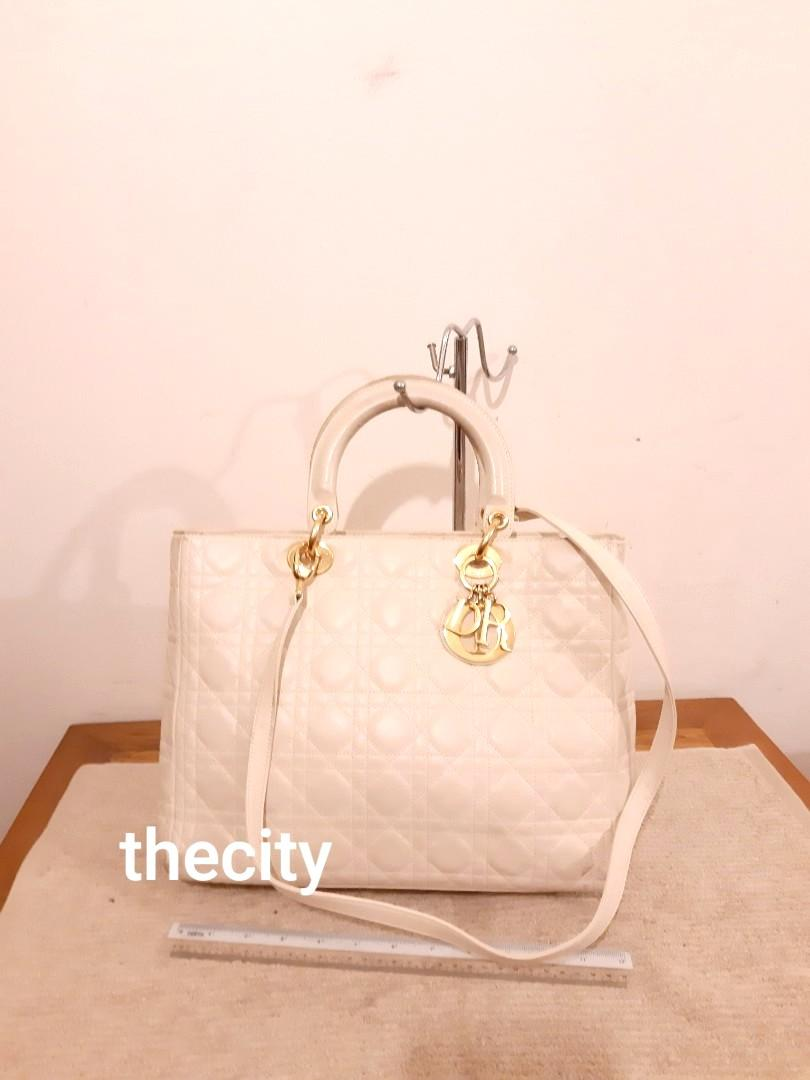 AUTHENTIC DIOR,  LARGE LADY DIOR - WHITE LAMBSKIN LEATHER - COMES WITH ITS ORIGINAL LONG CROSSBODY SLING STRAP - OVERALL OK - DIRT ON FOUR CORNERS, CAN TOUCH UP AT BAG SPA - (LARGE LAMBSKIN LADY DIOR BAGS NOW RETAIL AROUND RM 20,000+) - RM 1780 ONLY