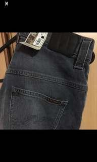 Nudie Jeans Taped Ted black blue jeans